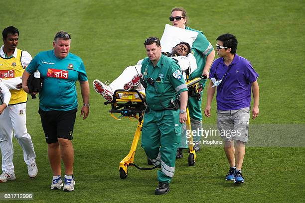 Imrul Kayes of Bangladesh is stretchered off after sustaining an injury during day four of the First Test match between New Zealand and Bangladesh at...
