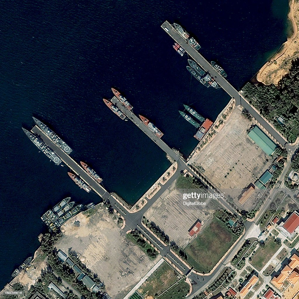 In 2010, Vietnam Prime Minister Nguyen Tan Dung announced an agreement with the U.S. to grant foreign navies access to the Cam Ranh Bay Naval Base, which is now undergoing renovation. Navies from all countries will be allowed to use the commercial repair facilities at Cam Ranh but will not be allowed to establish a permanent presence. This image shows the area of new construction and the existing facility at Cam Ranh Bay, where Vietnamese warships including frigates, corvettes and patrol vessels are present.