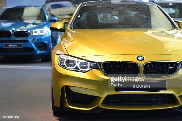 BMW M4 in a car showroom