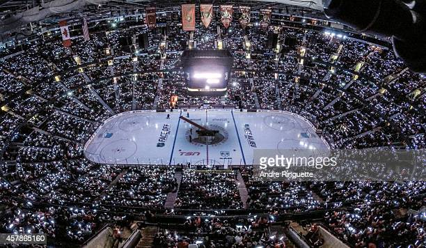 In a coordinated tribute with NHL games in Montreal and Toronto to honor Canadian soldiers who lost their lives this past week fans wave glow sticks...