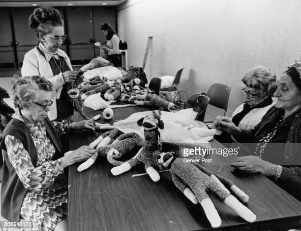 In a craft class at Jewish Community Center from left Mrs Dora Berenbeim Mrs Frieda Muskat Mrs Hilda Strauss and Mrs Jennie Began make dolls from...