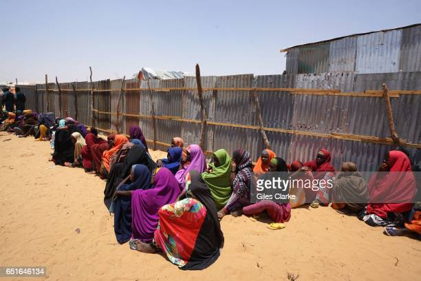 In a dusty suburb of Mogadishu recentlyarrived drought victims wait to enter a World Food Program aid center It is here that they will be registered...