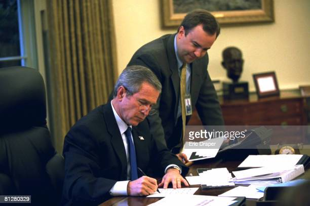 In a file photo President George W Bush works on a press statement with Principal Deputy White House Press Secretary Scott McClellan in the Oval...