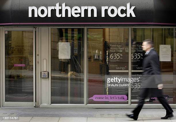 In a file picture taken on February 18 2008 a man walks past a branck of Northern Rock bank in London Britain said on November 17 2011 it will sell...