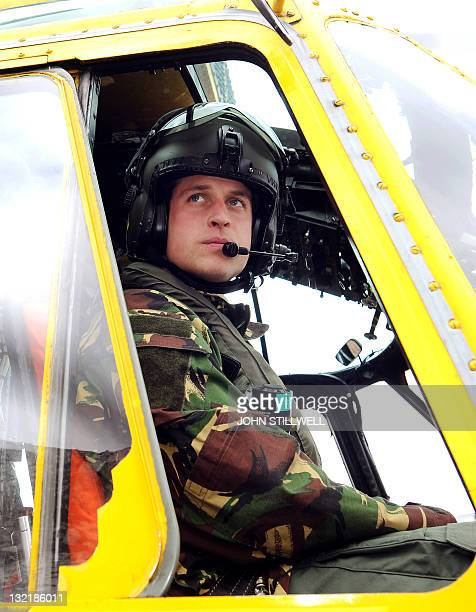 In a file picture taken on March 31 2011 Britain's Prince William is pictured at the controls of a Sea King helicopter during a training exercise at...