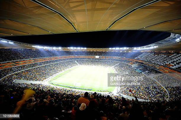 In a general view of the Soccer City Stadium pitch and stands supporters ahead of the international friendly football match between South Africa and...