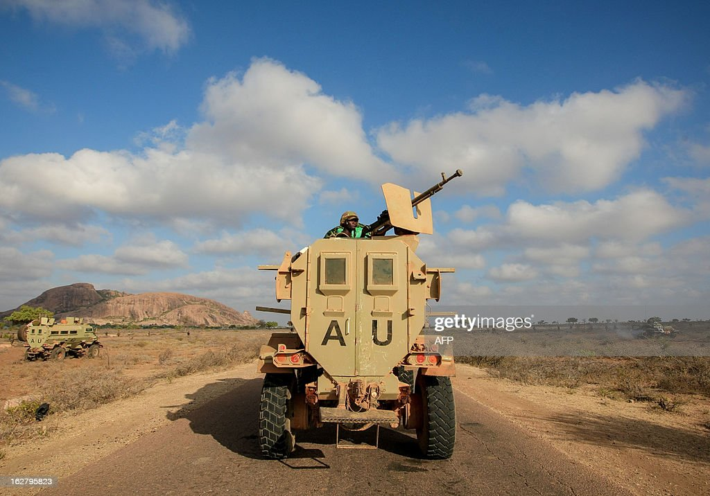 CREDIT 'AFP PHOTO / AU-UN IST PHOTO / STUART PRICE' - NO MARKETING NO ADVERTISING CAMPAIGNS - DISTRIBUTED AS A SERVICE TO CLIENTS In a handout photograph taken and released by the African Union-United Nations Information Support team on February 27, 2012, an armoured personnel carrier of Ugandan forces serving with the African Union Mission in Somalia (AMISOM) advances along a road toward the central Somali town of Buur-Hakba. The Somali National Army (SNA) supported by AMISOM forces captured the strategically important town on the Afgooye-Baidoa corridor in Bay region from Al-Qaeda-affiliated extremist group Al Shabaab early this morning without any resistance, marking a significant loss for the group. The town, located 64kms east of Baidoa, was a stronghold of the Shabaab where they extorted high levies of illegal taxation on the local civilian populations and used it as a base from where they planned and launched attacks against government forces and installations, AMISOM and the Somali population. Buur-Hakba is the latest in a string of significant territorial losses for the extremist group to SNA and AMISOM forces over the last 18 months, which has seen their area of influence and control over towns and areas across Somalia steadily decrease.