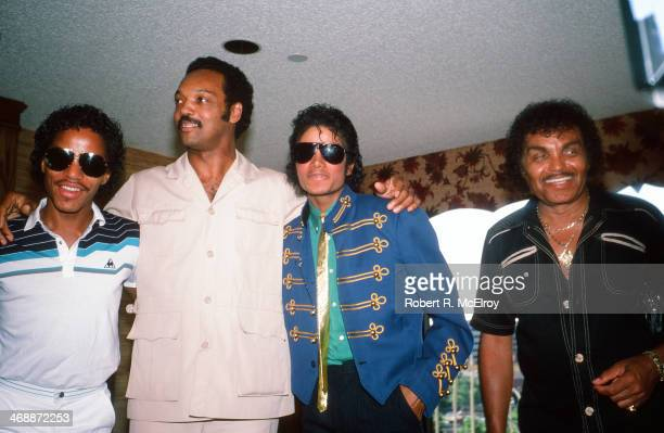 In a hotel room during the 1984 Democratic National Convention American sibling pop singers Marlon and Michael Jackson along with their father Joe...