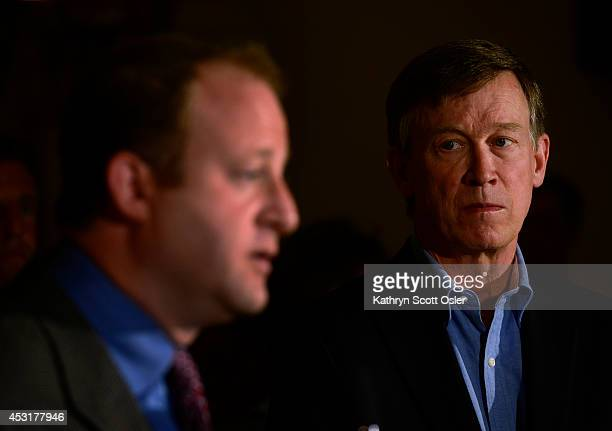 In a joint press conference inside the state capitol Gov John Hickenlooper right and US Rep Jared Polis DBoulder announce the formation of a task...