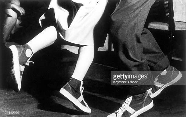 In a London cabaret around 1950 a closeup shot of the feet of those dancing the jitterbug a 64 time dance in double steps derived by white Americans...