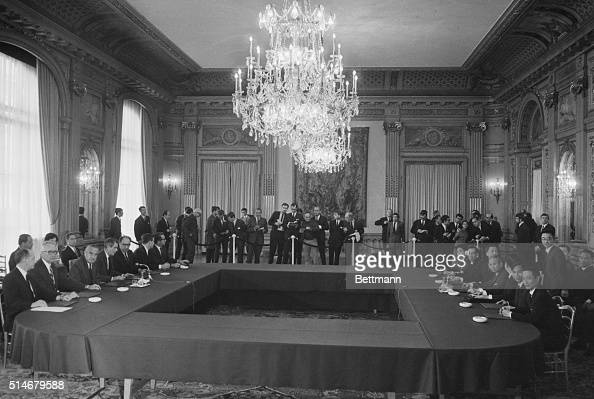 In a Paris conference room on May 13 representatives from the US and North Vietnam Ambassador Averell Harriman Cyrus Vance and Xuan Thu meet to...