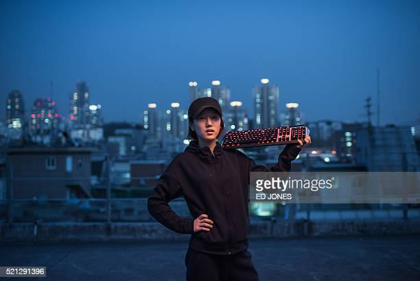 In a photo taken on April 11 2016 JiHee Lee of the allfemale League of Legends computer gaming team 'QWER' poses for a photo in Seoul Brought...