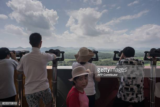 In a photo taken on August 1 2017 tourists look out towards North Korea at an observation point near the Joint Security Area within the Demilitarized...