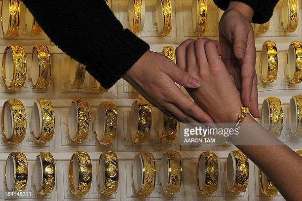 Hong kong jewellery stock photos and pictures getty images for Luk fook jewelry goldsmith