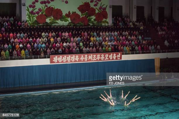 TOPSHOT In a photo taken on February 15 2017 swimmers perform in a synchronized swimming gala event in Pyongyang The gala was part of a series of...