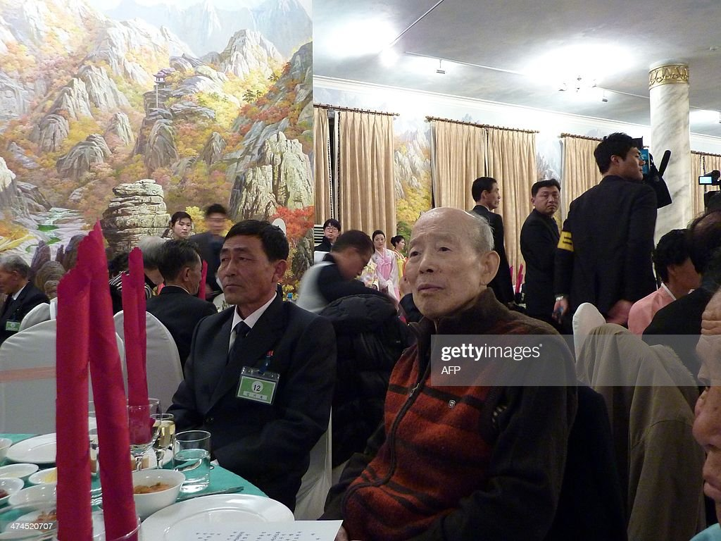 In a photo taken on February 20, 2014 South Korean Kim Se-Rin (R) sits his North Korean nephew Kim Ki-Bok (C) during a family reunion at the resort area of Mount Kumgang, North Korea. Among tens of thousands of wait-listed applicants, the 85-year-old was one of just 83 South Koreans chosen to participate in a meeting of family members divided by the 1950-53 Korean War. Kim left his hometown in the North Korean county of Hwangju in December 1950 at the height of the war to join the South Korean army, without telling his parents, his brother or his two sisters. In the six decades since, he had no contact with those he left behind, not knowing whether they were alive or dead. Millions of Koreans were separated by the conflict and permanent division of the peninsula. The joy of reunion is tempered by the pain of the inevitable -- and permanent -- separation at the end. Although he knew it would be near impossible to expect answers to more than 60 years worth of questions, Kim was grateful to have finally heard how his parents died and how his other relatives lived during the years since he left. Of the 125,000 South Koreans who have applied for reunions since 1988, 57,000 have died with time rapidly running out for those on the wait list.