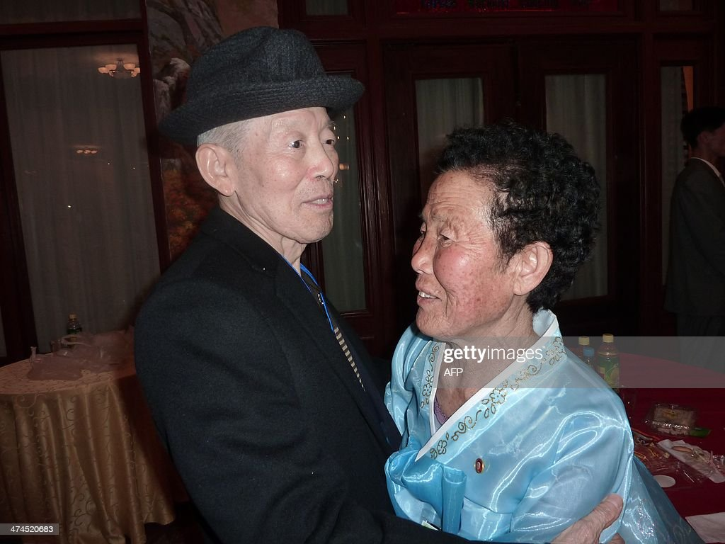 In a photo taken on February 22, 2014 South Korean Kim Se-Rin (L) sits his North Korean sister Kim Young-Sook (R) during a family reunion at the resort area of Mount Kumgang, North Korea. Among tens of thousands of wait-listed applicants, the 85-year-old was one of just 83 South Koreans chosen to participate in a meeting of family members divided by the 1950-53 Korean War. Kim left his hometown in the North Korean county of Hwangju in December 1950 at the height of the war to join the South Korean army, without telling his parents, his brother or his two sisters. In the six decades since, he had no contact with those he left behind, not knowing whether they were alive or dead. Millions of Koreans were separated by the conflict and permanent division of the peninsula. The joy of reunion is tempered by the pain of the inevitable -- and permanent -- separation at the end. Although he knew it would be near impossible to expect answers to more than 60 years worth of questions, Kim was grateful to have finally heard how his parents died and how his other relatives lived during the years since he left. Of the 125,000 South Koreans who have applied for reunions since 1988, 57,000 have died with time rapidly running out for those on the wait list. AFP PHOTO