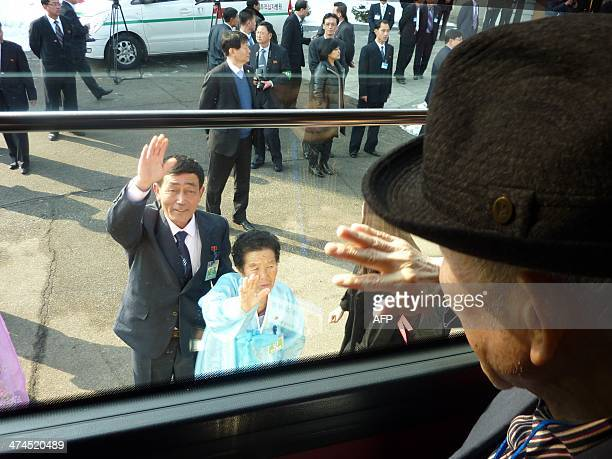 In a photo taken on February 22 2014 South Korean Kim SeRin waves goodbye from a bus to his North Korean sister Kim YoungSook and nephew Kim KiBok as...