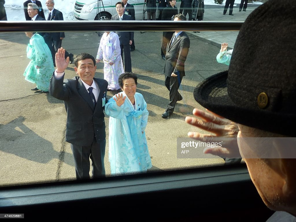 In a photo taken on February 22, 2014 South Korean Kim Se-Rin (R) waves goodbye from a bus to his North Korean sister Kim Young-Sook (C) and nephew Kim Ki-Bok (centre L) as he departs a family reunion at the resort area of Mount Kumgang, North Korea. Among tens of thousands of wait-listed applicants, the 85-year-old was one of just 83 South Koreans chosen to participate in a meeting of family members divided by the 1950-53 Korean War. Kim left his hometown in the North Korean county of Hwangju in December 1950 at the height of the war to join the South Korean army, without telling his parents, his brother or his two sisters. In the six decades since, he had no contact with those he left behind, not knowing whether they were alive or dead. Millions of Koreans were separated by the conflict and permanent division of the peninsula. The joy of reunion is tempered by the pain of the inevitable -- and permanent -- separation at the end. Although he knew it would be near impossible to expect answers to more than 60 years worth of questions, Kim was grateful to have finally heard how his parents died and how his other relatives lived during the years since he left. Of the 125,000 South Koreans who have applied for reunions since 1988, 57,000 have died with time rapidly running out for those on the wait list.