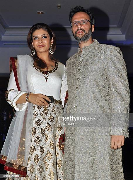 In a photo taken on January 31 Indian Bollywood actress Raveena Tandon and her husband attend the wedding ceremony of Ritesh Deshmukh and Genelia...