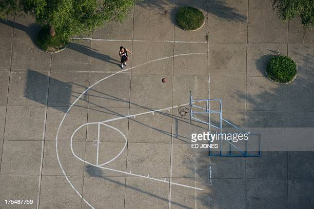 In a photo taken on July 27 2013 a man shoots for a basket on a basketball court in Pyongyang North Korea mounted its largest ever military parade on...