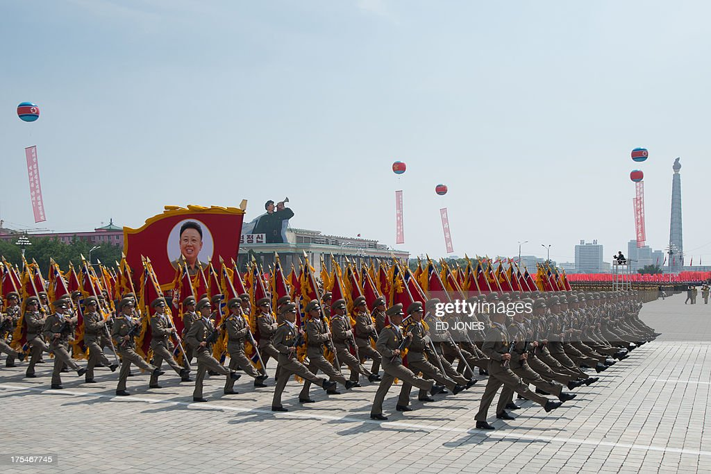 In a photo taken on July 27 2013 North Korean soldiers march on Kim IlSung square during a military parade marking the 60th anniversary of the Korean...