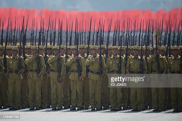 In a photo taken on July 27 2013 North Korean soldiers stand on Kim IlSung square during a military parade marking the 60th anniversary of the Korean...