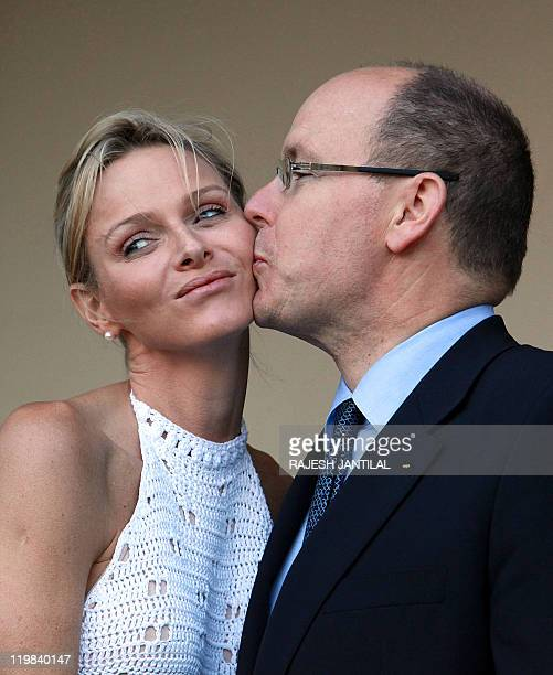 In a photo taken on July 6 Prince Albert of Monaco kisses his new bride Princess Charlene during a meeting with South African President Jacob Zuma at...