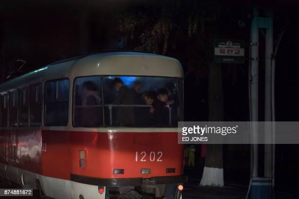 In a photo taken on November 15 commuters ride a tram in Pyongyang / AFP PHOTO / Ed JONES