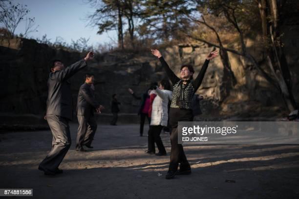 In a photo taken on November 15 people dance in a park in Pyongyang / AFP PHOTO / Ed JONES