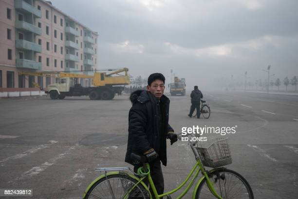 In a photo taken on November 21 a man waits to cross a street in Rason At the northeastern tip of North Korea where the isolated nucleararmed country...