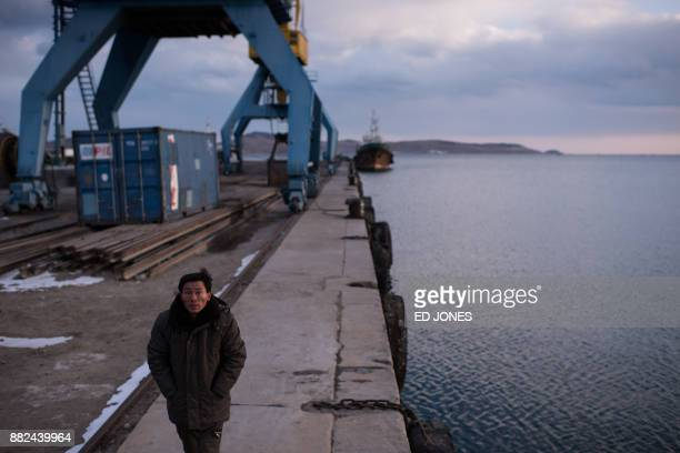 In a photo taken on November 21 a man walks along a dock at the port in Rason At the northeastern tip of North Korea where the isolated nucleararmed...