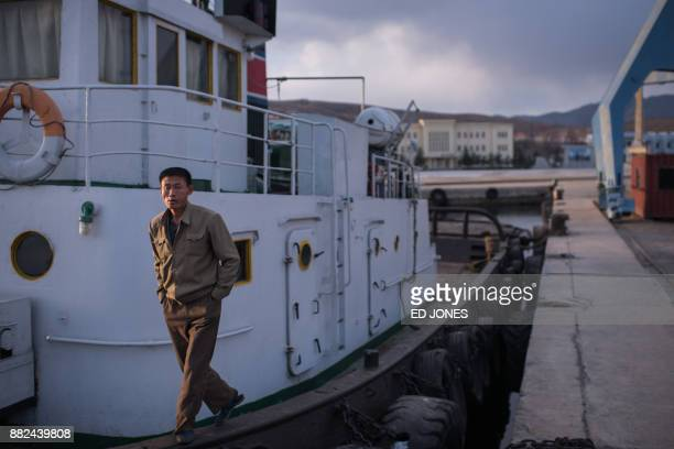 In a photo taken on November 21 a sailor stands on his boat in the port in Rason At the northeastern tip of North Korea where the isolated...
