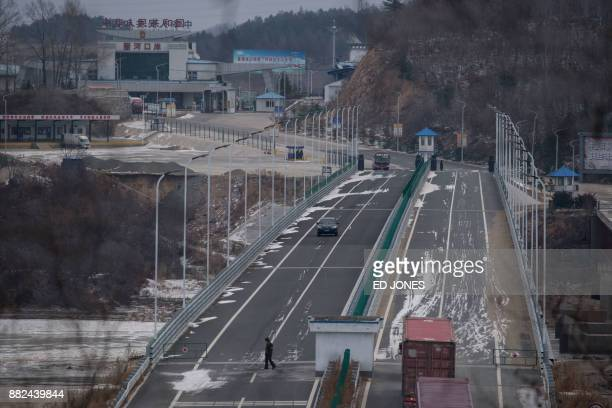 In a photo taken on November 21 a truck entering the Rason Special Economic Zone makes its way across a bridge marking the border between North Korea...