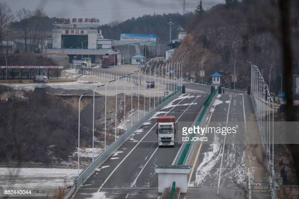 In a photo taken on November 21 a truck entering the Rason Special Economic Zone makes its way across a bridge over the Tumen river marking the...