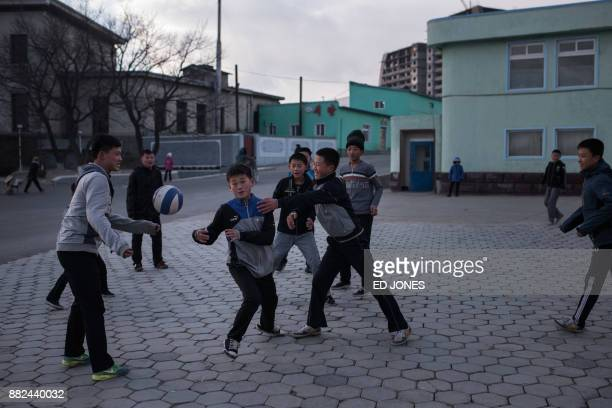 In a photo taken on November 21 children play with a ball in a public square in Rason At the northeastern tip of North Korea where the isolated...