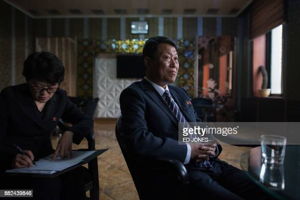 In a photo taken on November 21 Rason city official Kim Yong Nam speaks to AFP in the North Korean city At the northeastern tip of North Korea where...