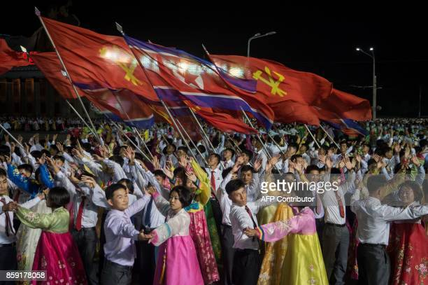 TOPSHOT In a photo taken on October 8 2017 participants described as 'working people youth and students of Pyongyang' perform during a mass gala...