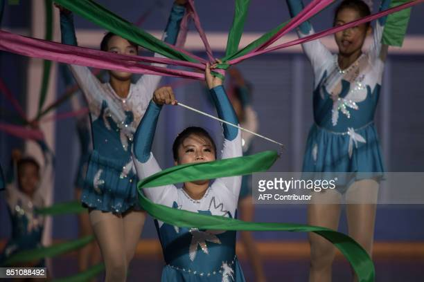 In a photo taken on September 21 2017 dancers perform during the 20th ITF World Taekwondo Championships in Pyongyang The world of taekwondo is even...