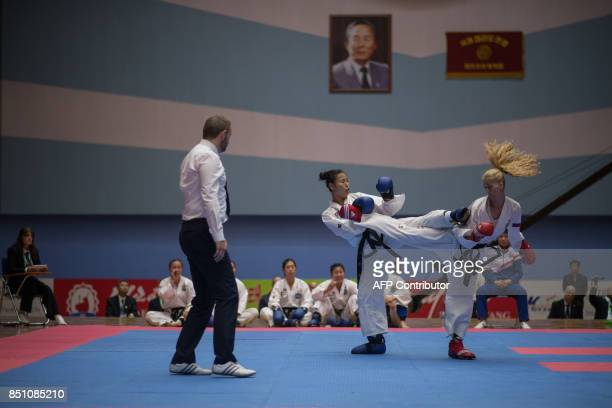 TOPSHOT In a photo taken on September 21 2017 team members from North Korea and Russia fight during the women's team event of the 20th ITF World...