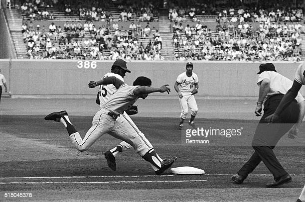 In a photofinish to first base the Los Angeles Dodger's Willie Davis races St Louis Cardinals pitcher Bob Gibson to the bag in the first inning here...