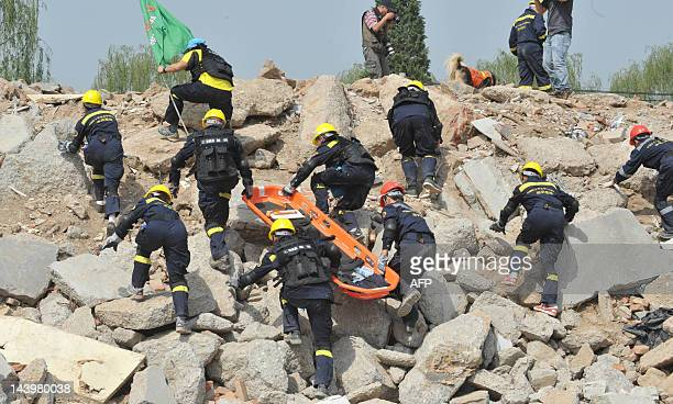 In a photograph taken on May 6 members of the Emergency Volunteer Service Corps undergo an earthquake rescue training drill in Beijing The US and...