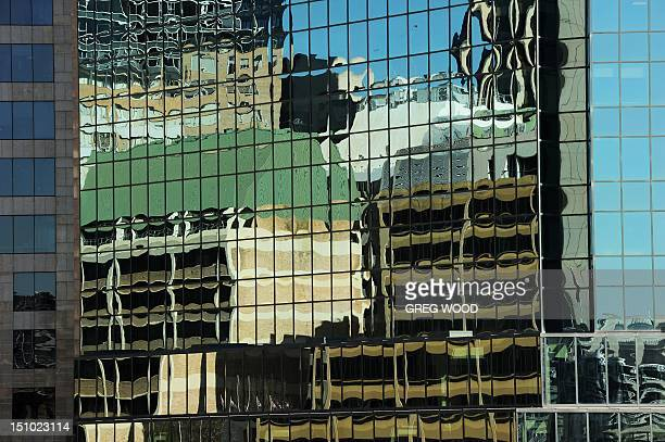 In a picture taken on August 3 a neighbouring building is reflected in the windows of a highrise office block in Sydney's central business district...