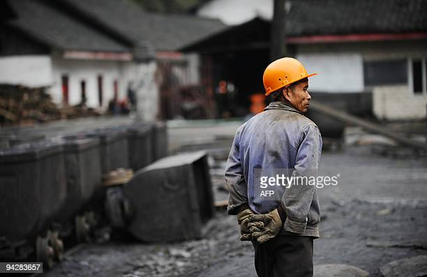In a picture taken on December 10 2009 a n elderly coal miner strolling through the Changyuan mine the last one to shut down in Chengdu in compliance...