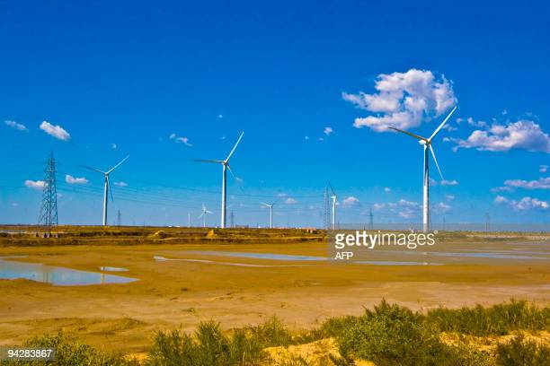 In a picture taken on December 10 2009 Wind turbines dot the landscape on the outskirts of Dongying in central China's Shandong province The world's...