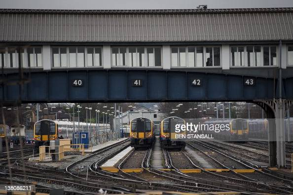 In a picture taken on January 19 2012 trains are seen at Clapham Junction train station in south London Delays in rail transport communication...