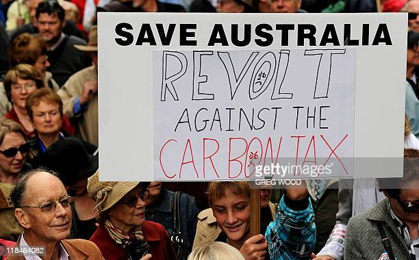 In a picture taken on July 1 2011 a protester holds a placard during a protest in Sydney against plans to introduce a carbon tax Australia's...