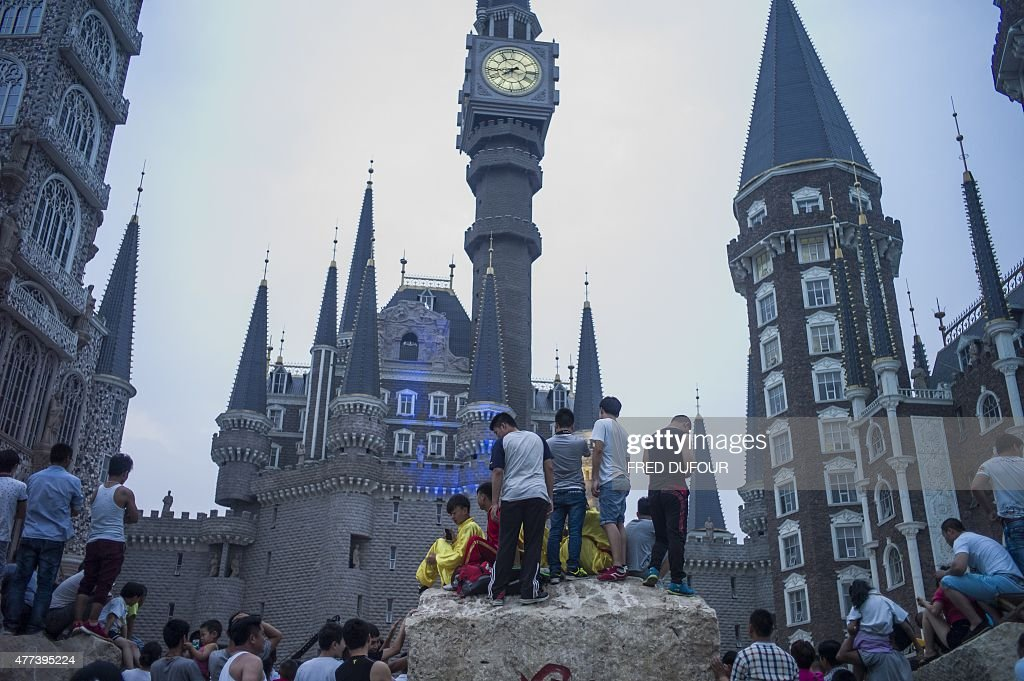 In a picture taken on June 16 people gather in front of the campus of Hebei Academy of Fine Arts after a graduation ceremony in Xinle Hebei province...
