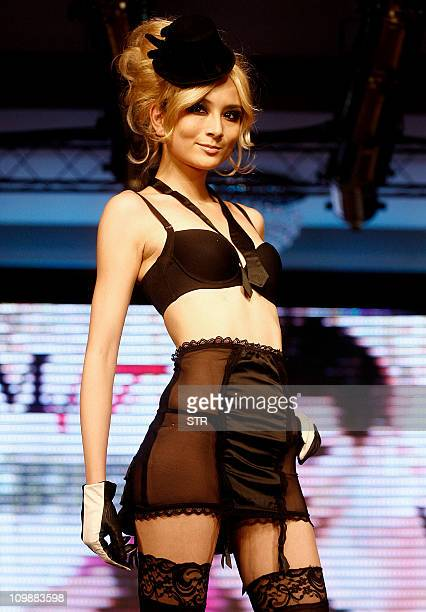 In a picture taken on March 6 2011 a model parades a lingerie creation by Chinese fashion house Maniform at a show in Wuhan in central China's Hubei...