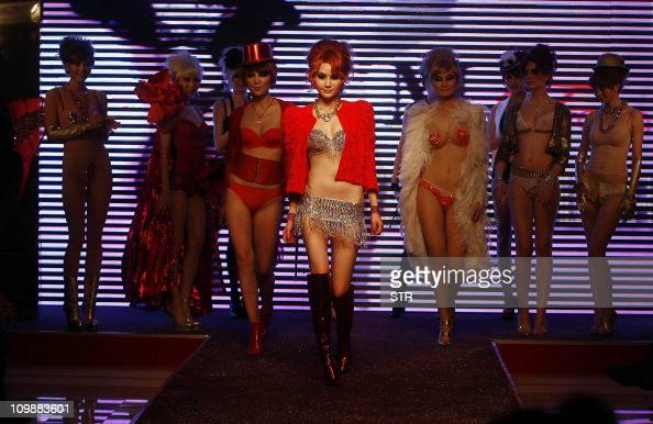 In a picture taken on March 6 2011 models parade lingerie creations by Chinese fashion house Maniform at a show in Wuhan in central China's Hubei...